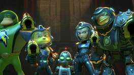 """In thisimage released by Gramercy Pictures, from left, Captain Qwark voiced by Jim Ward,  Ratchet voiced by James Arnold Taylor, Clank voiced by David Kaye, Cora voiced by Bella Thorne and Brax, voiced by Vincent Tong, appear in a scene from, """"Ratchet and Clank."""" From the reviled 1993 live-action rendition of """"Super Mario Bros."""" to last year's loathed arcade-inspired """"Pixels,"""" big-screen interpretations of games have almost always failed to score with critics and audiences. With four films based on popular interactive series set for release in 2016, this could be the year a video game movie wins over filmgoers. (Gramercy Pictures  via AP)"""