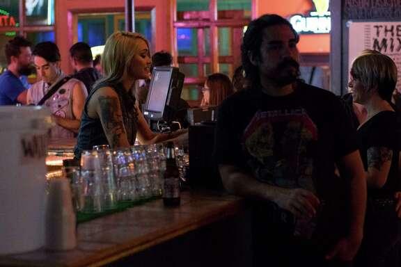 Regulars crowd around the bar at The Mix.