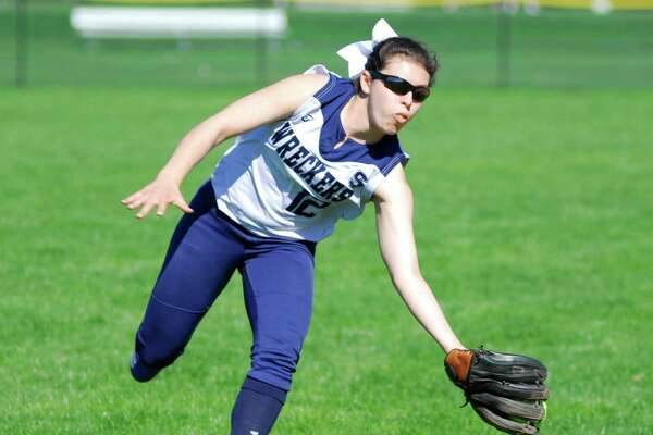 Staples shortstop Gabby Perry makes a catch in foul territory during a game against Warde on Tuesday. The Wreckers lost 5-4.