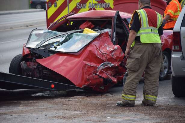 Emergency crews work a wrong-way crash on Culebra Road on Thursday, April 28, 2016. Three women — the drivers of three different vehicles — were hospitalized following the violent wreck.   Emergency crews work a wrong-way crash on Culebra Road on Thursday, April 28, 2016. Three women — the drivers of three different vehicles — were hospitalized following the violent wreck.