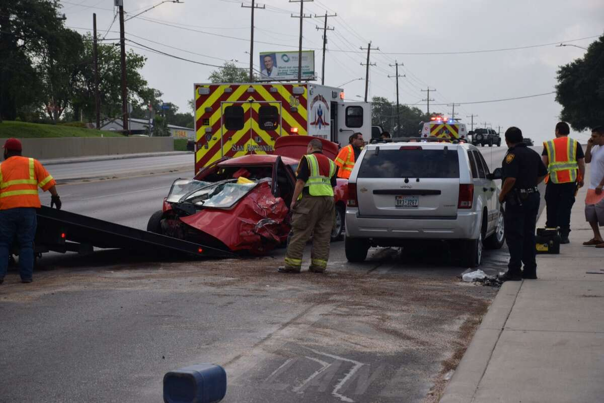 Emergency crews work a wrong-way crash on Culebra Road on Thursday, April 28, 2016. Three women - the drivers of three different vehicles - were hospitalized following the violent wreck. Emergency crews work a wrong-way crash on Culebra Road on Thursday, April 28, 2016. Three women - the drivers of three different vehicles - were hospitalized following the violent wreck.