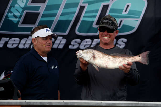 Fisherman Clark Jordan holds up one of his fish during the final weigh-in Elite Redfish Series' Classic Kick Off tournament in Orange on Sunday afternoon. Jordan won the tournament.  Photo taken Sunday 4/10/16 Ryan Pelham/The Enterprise