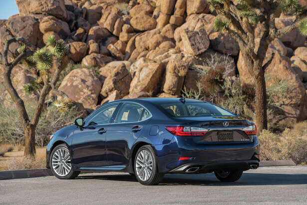 The refreshed 2016 ES 350 has new taillights and chrome-tipped exhaust tips inspired by the flagship LS luxury sedan.
