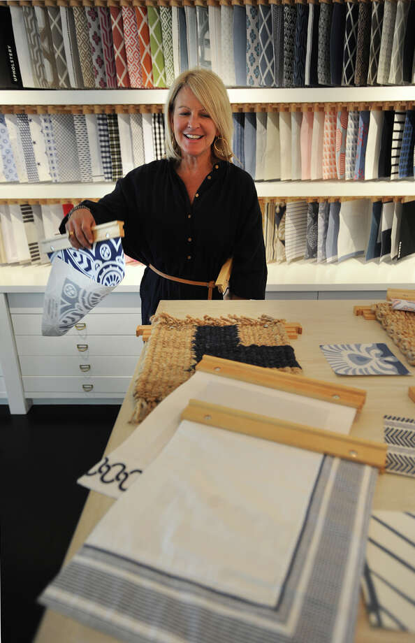 CEO Lori Greeley pulls color swatches in the design lab of Serena & Lily's new flagship store in the historic 1889 Kemper-Gunn House at 35 Elm Street in Westport, Conn. on Tuesday, April 26, 2016. Photo: Brian A. Pounds / Hearst Connecticut Media / Connecticut Post