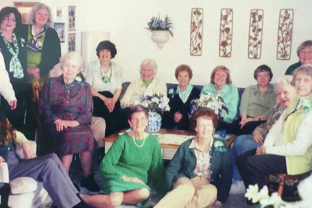 Members of the Garden Club of New Milford recently attended the annual St. Patrick's Day luncheon at the home of member and hostess chairwoman Barbara Clark. Those who attended are shown above, from left to right, in front, seated, Ellen Seidman, Helen Veo, Jane Peterson, mostly hidden, Barbara Clark, Betty Krause, Meredith Mateer and Kathy Hyland, and in back, Karen Evans, Janet Parsons, Lynne Best, Virginia Driscoll, Sally Milligan, Lillian Flankenstein, Adrienne Coppolla, Chris Wharton and Kathy Elmore.