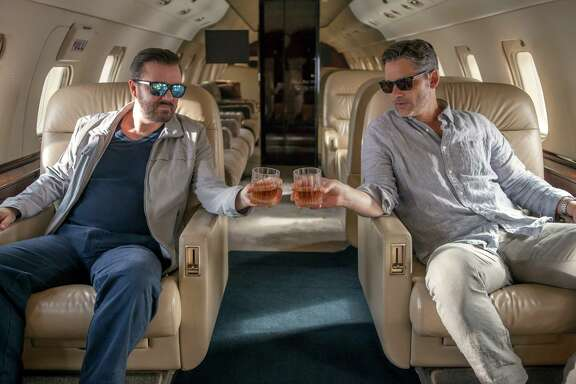 """Ricky Gervais, left, and Eric Bana in Netflix's """"Special Correspondents."""""""