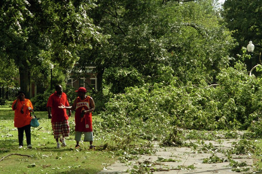 June 24, 2010: Washington Park, in Bridgeport, Conn. was a mess as trees were uprooted during a tornado hit on Thursday June 24, 2010. Photo: Christian Abraham / ST / Connecticut Post