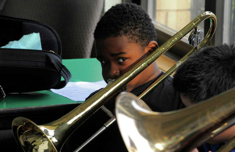 Troy Baker plays trombone as he performs with peers in a brass ensemble last month at the Addison Community Center in Stamford as part of Project Music. Photo: Matthew Brown / Hearst Connecticut Media / Stamford Advocate