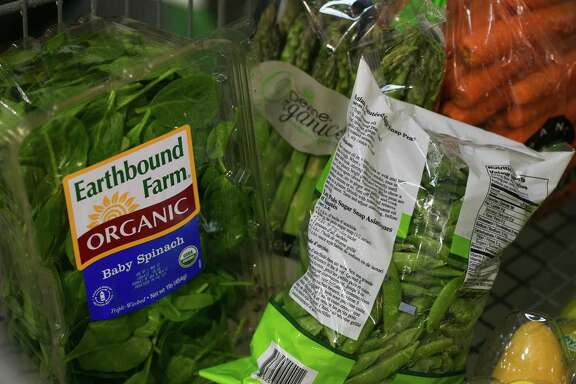 A shopper's cart is full of organic produce at Costco in Issaquah, Wash. Sales of organic food jumped from $11.13 billion in 2004 to $35.95 billion in 2014, according to the Organic Trade Association, which represents the supply chain from farmers to retailers.