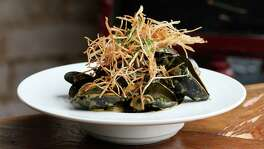 Mussels from Prince Edward Island in Canada are cooked in green curry and served with shoestring fries and coconut salt.
