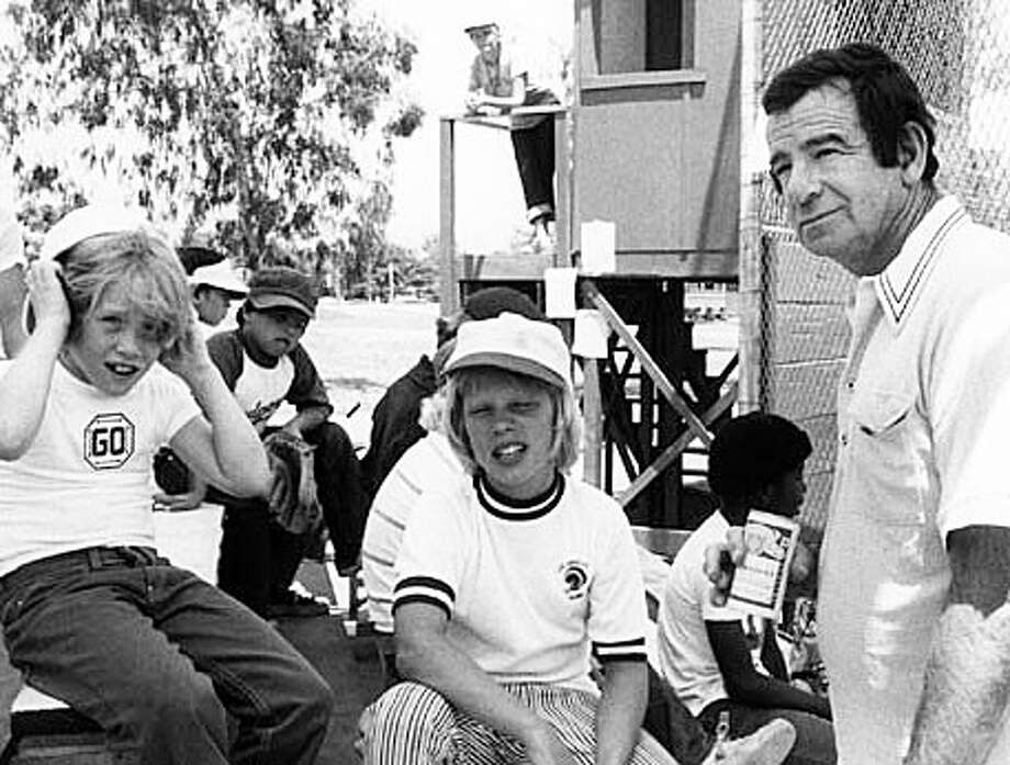 """Dave Stambaugh, center, as Toby Whitewood in the movie, """"The Bad News Bears,"""" with lead actor Walter Matthau, right. The movie marks its 40th anniversary this year, and Stambaugh is now the interim minister of faith formation at the Congregational Church of Green's Farms. Photo: Contributed Photo / Westport News"""