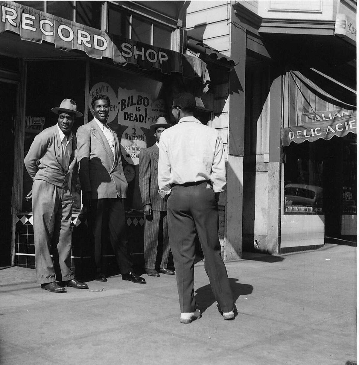 """During the musical heyday of San Francisco�s Fillmore District in the 1940�s and 1950�s, the area was known as the """"Harlem of the West."""" People wanted to forget the war by being entertained and a network of musicians, ands, clubs, and bars filled the need. Left to right are John Handy, Pony Poindexter, John Coltrane, and Franck Fisher. Photo credit: Steve Jackson Photo D The Western Addition was one of San Francisco�s most thriving shopping and entertainment areas.It was vibrant with hope and economic vitality. But as the shipyards closed African Americas were finding it difficult to compete for jobs with returning soldiers. Racial discrimination mounted, and unemployment in the neighborhood grew. Photo credit: David Johnson NOTE: it's unclear which caption goes w/this photo tho the first seems most logical. HANDOUT"""
