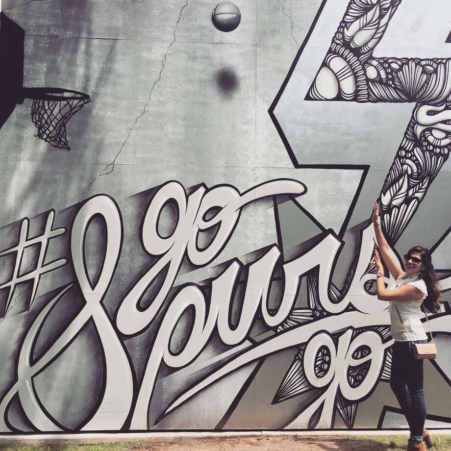 The new Spurs mural at Travis Park gives the opportunity to act as if they are shooting a shot for the team.