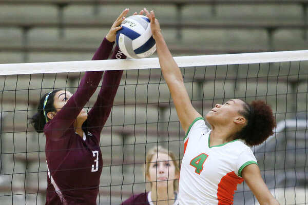 Highlands' Jenelle Rodriguez (left) blocks a shot at the net by Sam Houston's Rita Davis during their match at Alamo Convocation Center on Wednesday, Oct. 14, 2015.  Highlands beat Sam Houston in 4 games:  21-25, 25-14, 25-23, 25-13.   MARVIN PFEIFFER/ mpfeiffer@express-news.net
