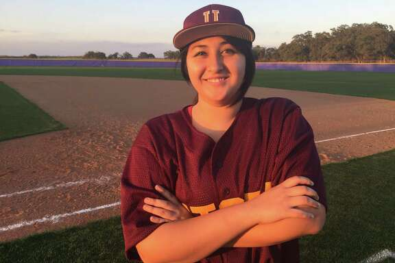 Sara Davis has played first base for the Utopia High School baseball team this season. The school has struggled to field a team because of a lack of players.