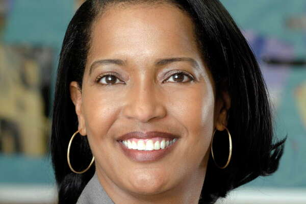 This April 2016 photo released by the Waterbury Public Schools shows Jahana Hayes in Waterbury, Conn., a history teacher at John F. Kennedy High School who was selected as the National Teacher of the Year announced Thursday, April 28, by the Council of Chief State School Officers. She will be recognized by President Barack Obama at a White House ceremony on Tuesday, May 3. (David Therault/Waterbury Public Schools via AP) MANDATORY CREDIT.