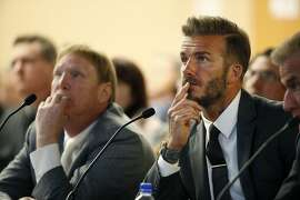 Former soccer player David Beckham, right, and Oakland Raiders owner Mark Davis, left, listen at a meeting of the Southern Nevada Tourism Infrastructure Committee, Thursday, April 28, 2016, in Las Vegas. Mark Davis says he wants to move the team to Las Vegas and is willing to spend a half billion dollars as part of a deal for a new stadium in the city. (AP Photo/John Locher)