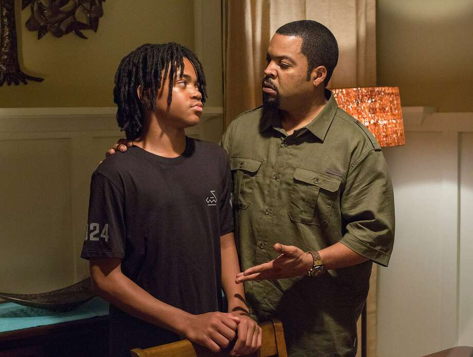 "Michael Rainey Jr. (left) and Ice Cube in ""Barbershop: The Next Cut."" Photo: Chuck Zlotnick, AP"
