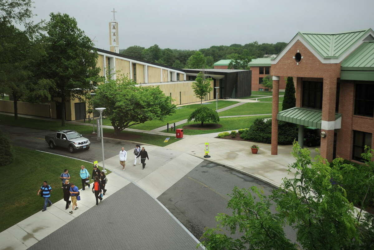 Students walk across the Sacred Heart University campus in Fairfield, Conn. on Sunday, June 12, 2014.