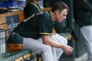 Oakland Athletics pitcher Chris Bassitt sits in the dugout after being relieved against the Detroit Tigers in the fourth inning of a baseball game in Detroit, Thursday, April 28, 2016. (AP Photo/Paul Sancya)