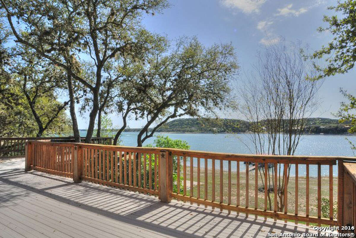 Address: 918 Pebble Beach Drive Area: NW Pipe Creek, TX 78063 This is a beautiful waterfront log home on Medina Lake. The view of the lake out of the living room, dining room or kitchen is worth being here. The amazing layout of the kitchen and all the cabinets with the center island create a great entertainment atmosphere. It is all one level to enter and inside, but there is a back staircase to walk down to the lake. The open floor plan is a pure pleasure. There are numerous porches, decks and options for places to be outside and enjoy the lake. Janet Springer | Coldwell Banker D'Ann Harper | jspringer@cbharper.com | 830.816.2211