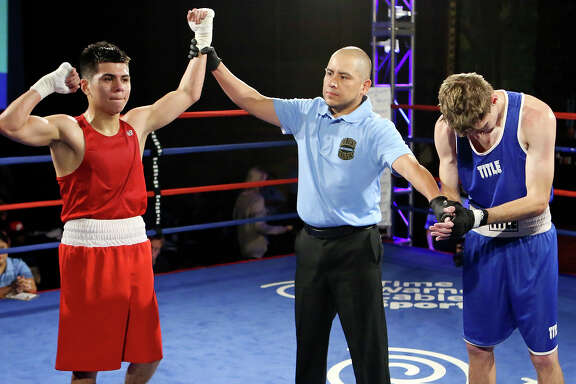 Guillermo Gutierrez (left) celebrates his unanimous decision win over Daniel Reed (right) after their open flyweight championship bout part of the 2016 San Antonio Regional Golden Gloves boxing tournament finals on Feb. 27, 2016 at the Scottish Rite Auditorium.