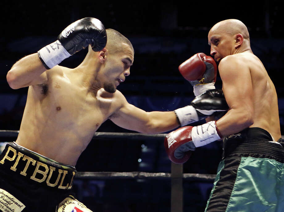 Javier Rodriguez (left) and Alejandro Moreno exchange punches during their super bantamweight bout part of the Premier Boxing Champions card on Dec. 12, 2015 at the AT&T Center. Photo: Edward A. Ornelas /San Antonio Express-News / © 2015 San Antonio Express-News