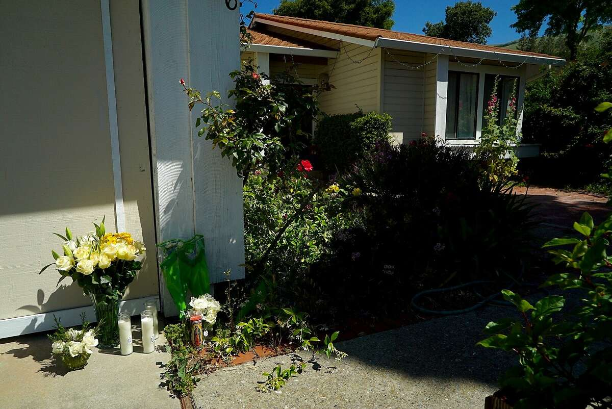 A memorial to Golam and Shamima Rabbi is seen in front of their home in San Jose, Calif. on Wednesday, April 28, 2016. Their two children were arrested on suspicion for the murder.
