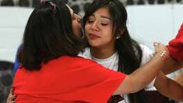 Gracie Alvarado, left, hugs her daughter, Samantha Alvarado, 18, as seniors from the Young Women's Leadership Academy participate in Signing Day, Thursday, April 28, 2016. Thirty-five seniors signed with four-year universities throughout the U.S. and had a combined $5.7 million in scholarships. Alvarado will attend the University of the Incarnate Word.