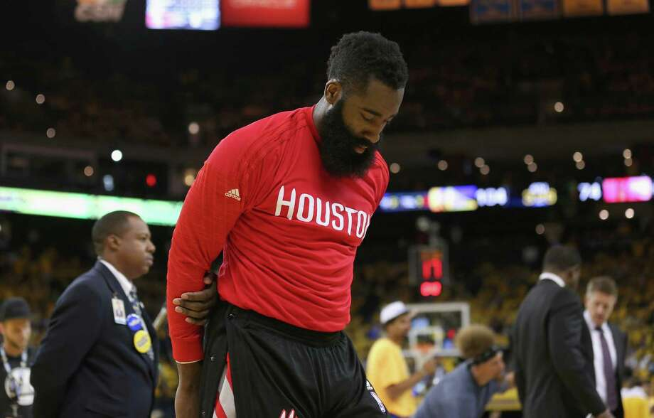 OAKLAND, CA - APRIL 27:  James Harden #13 of the Houston Rockets stands on the side of the court during a time out in the final minutes of their loss to the Golden State Warriors in Game Five of the Western Conference Quarterfinals during the 2016 NBA Playoffs at ORACLE Arena on April 27, 2016 in Oakland, California. NOTE TO USER: User expressly acknowledges and agrees that, by downloading and or using this photograph, user is consenting to the terms and conditions of Getty Images License Agreement.  (Photo by Ezra Shaw/Getty Images) Photo: Ezra Shaw, Staff / 2016 Getty Images