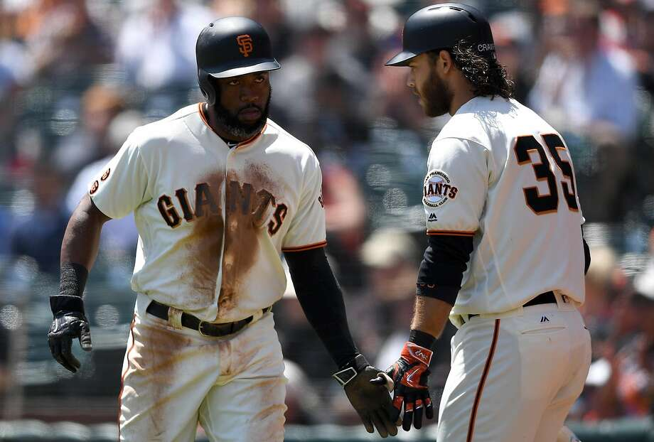 Denard Span (left) scores in the first inning Wednesday — something he'd like to do more often. Photo: Thearon W. Henderson, Getty Images