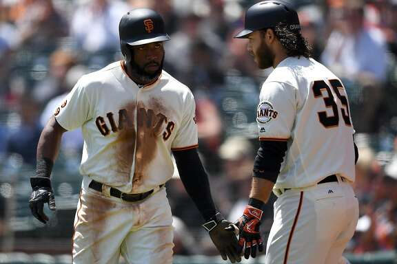SAN FRANCISCO, CA - APRIL 27:  Denard Span #2 of the San Francisco Giants is congratulated by Brandon Crawford #35 after Span scored against the San Diego Padres in the bottom of the first inning at AT&T Park on April 27, 2016 in San Francisco, California.  (Photo by Thearon W. Henderson/Getty Images)