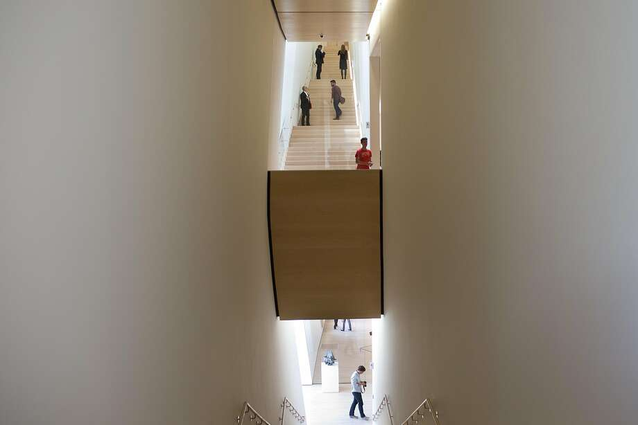 Members of the press get a preview of the renovated San Francisco Museum of Modern Art. The museum opens to the public May 14. Photo: Tim Hussin, The Chronicle