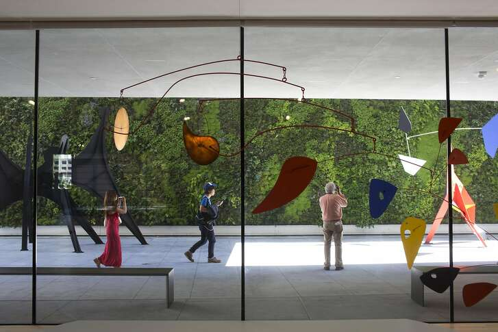 An Alexander Calder mobile hangs in front of the living wall sculpture terrace at the San Francisco Museum of Modern Art on April, 28, 2016 in San Francisco, Calif.  The museum opens to the public on May 14.