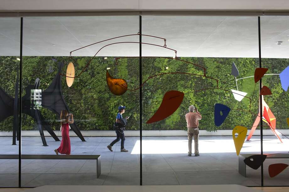 An Alexander Calder mobile hangs in front of the living wall sculpture terrace at the San Francisco Museum of Modern Art on April, 28, 2016 in San Francisco, Calif.  The museum opens to the public on May 14. Photo: Tim Hussin, The Chronicle