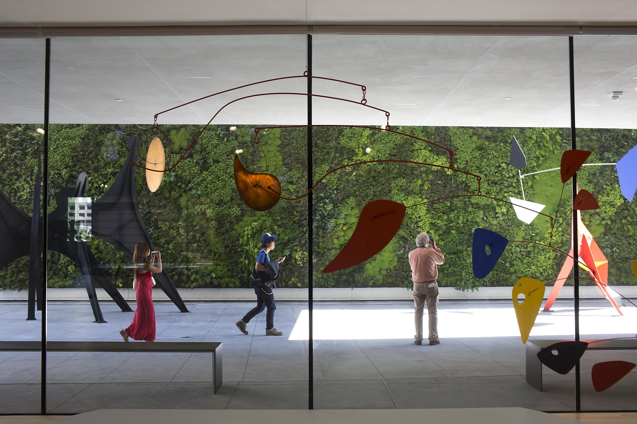 An Alexander Calder Mobile Hangs In Front Of The Living Wall Sculpture  Terrace At The San