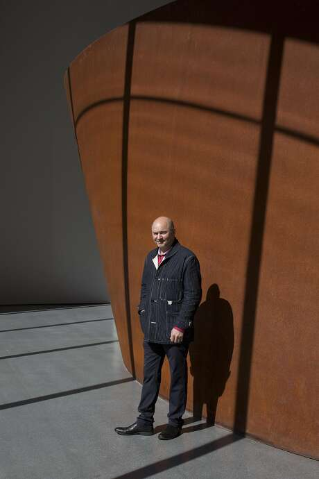 Dykers stands in front of a Richard Serra sculpture at SFMOMA. His firm has opened a San Francisco office since winning the museum commission. Photo: Tim Hussin, The Chronicle