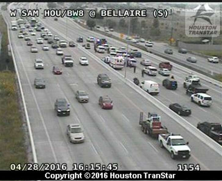 Emergency responders work the scene of an officer-involved shooting at Beltway 8 near the Bellaire exit on Thursday, April 28, 2016. According authorities, a Precinct 5 toll road deputy fatally shot and killed a suspect.