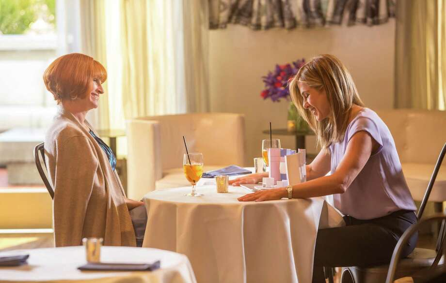 """This image released by Open Road Films shows Julia Roberts, left, and Jennifer Aniston in a scene from """"Mother's Day."""" (Ron Batzdorff /Open Road Films via AP) ORG XMIT: NYET131 Photo: Ron Batzdorff / Open Road Films"""