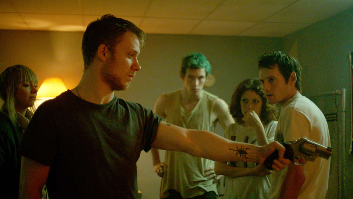 """This image released by A24 Films shows, from left, Imogen Poots, Joe Cole, Callum Turner, Alia Shawkat and Anton Yelchin in a scene from, """"Green Room."""" (Scott Green/A24 via AP)"""