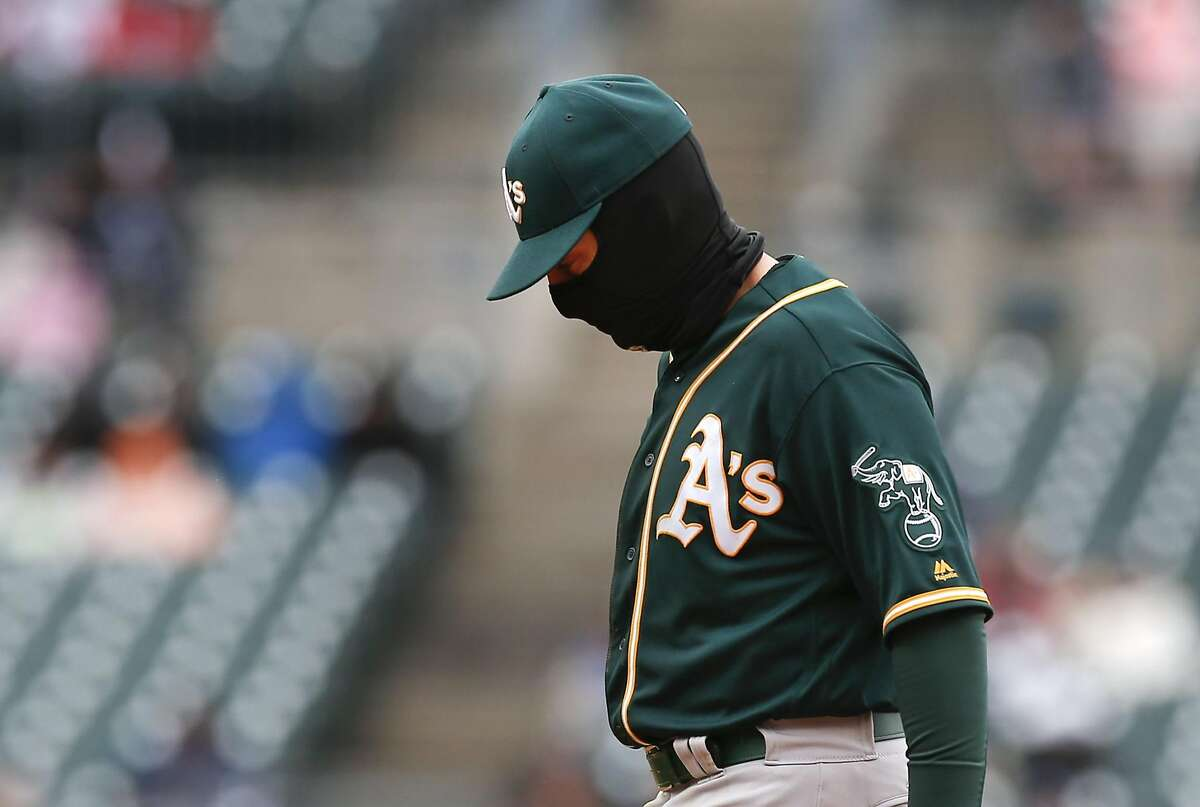 Oakland Athletics second baseman Jed Lowrie wears a Balaclava against the Detroit Tigers in the seventh inning of a baseball game in Detroit, Thursday, April 28, 2016. (AP Photo/Paul Sancya)