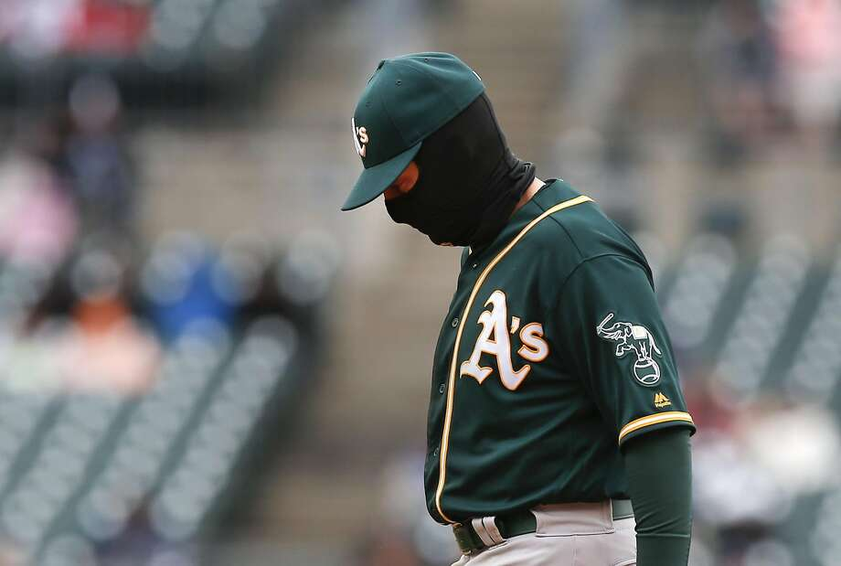 Oakland Athletics second baseman Jed Lowrie wears a Balaclava against the Detroit Tigers in the seventh inning of a baseball game in Detroit, Thursday, April 28, 2016. (AP Photo/Paul Sancya) Photo: Paul Sancya, Associated Press