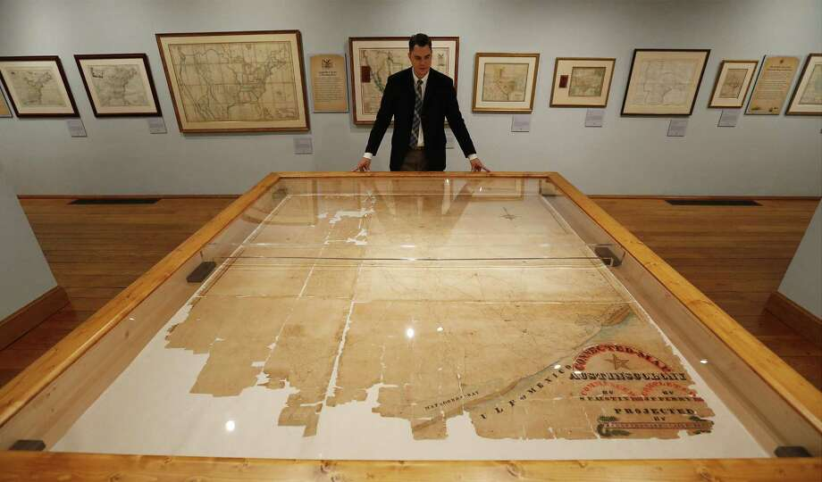"Texas General Land Office's James Harkins overlooks a map created by Stephen F. Austin called the ""Connected Map"" as the Witte Museum in collaboration with the Texas General Land Office opened the exhibit, ""Mapping Texas: From Frontier to the Lone Star State"" on April 28, 2016. Photo: Kin Man Hui /San Antonio Express-News / ©2016 San Antonio Express-News"