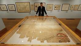 "James Harkins of the General Land Office looks at Stephen F. Austin's ""Connected Map"" at the Witte Museum. ""Mapping Texas: From Frontier to the Lone Star State,"" featuring items from the sixteenth through the nineteenth centuries, runs through Sept. 5."