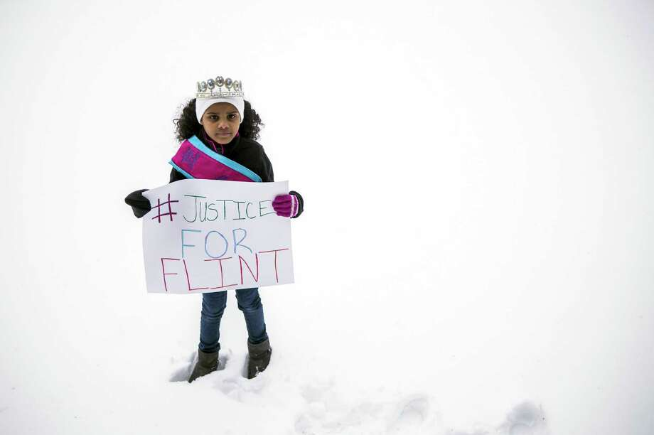 Flint resident Mari Copeny, 8, joined a rally last month shortly before attending U.S. House hearings in Washington and writing a letter requesting a presidential visit to the city.  Photo: Jake May, MBI / The Flint Journal-MLive.com