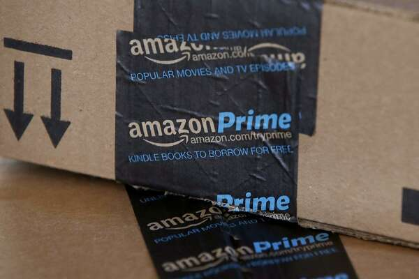 FILE - This June 4, 2014, file photo, shows Amazon boxes in Phoenix. Amazon reports financial results Thursday, April 28, 2016. (AP Photo/Ross D. Franklin, File)