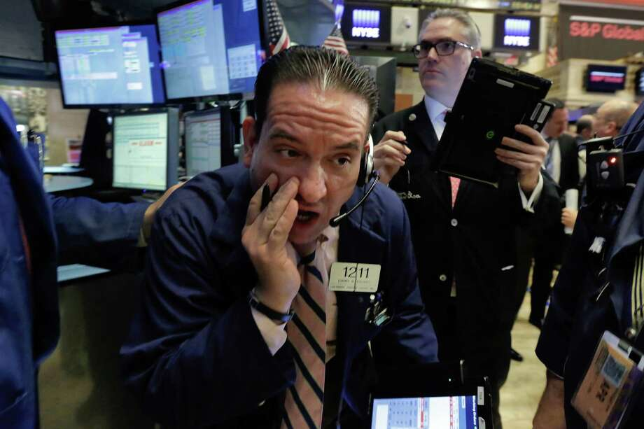 Trader Tommy Kalikas, center, works on the floor of the New York Stock Exchange, Thursday, April 28, 2016. Stocks are opening broadly lower on Wall Street as traders look over the latest batch of earnings and deal news. (AP Photo/Richard Drew) ORG XMIT: NYRD102 Photo: Richard Drew / Copyright 2016 The Associated Press. All rights reserved. This m