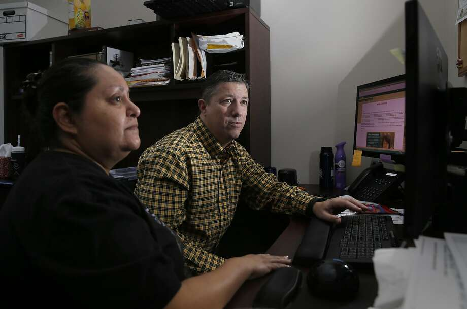 IT members Will Baily and Anna Perez, on Thurs. April 28, 2016, thwarted a ransom ware attack before it could take hold throughout their network at the offices of The Catholic Charities of Santa Clara County in Mountain View, California Photo: Michael Macor, The Chronicle