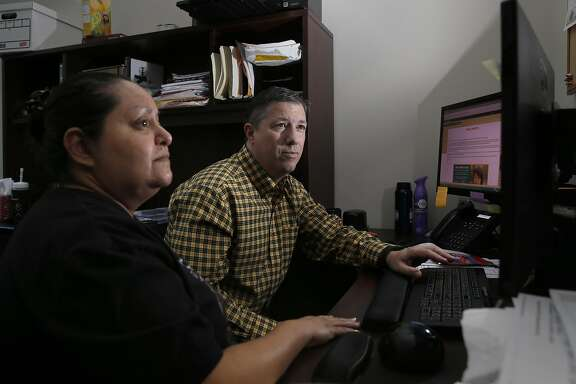IT members Will Baily and Anna Perez, on Thurs. April 28, 2016, thwarted a ransom ware attack before it could take hold throughout their network at the offices of The Catholic Charities of Santa Clara County in Mountain View, California