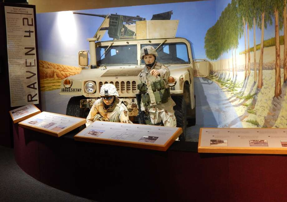 A display at the U.S. Army Women's Museum shows the role played by Sgt. Leigh Ann Hester during a 2005 attack on her convoy in Iraq. Photo: U.S. Army Women's Museum